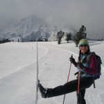 Erika high kicking it with her skate skis along the Teton Park Rd.